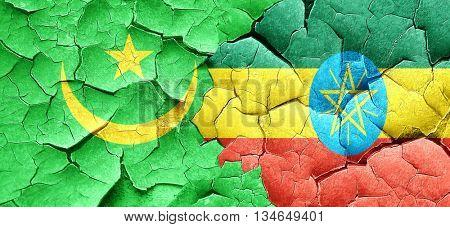 Mauritania flag with Ethiopia flag on a grunge cracked wall