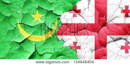 Mauritania flag with Georgia flag on a grunge cracked wall