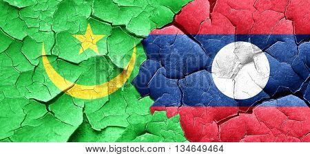Mauritania flag with Laos flag on a grunge cracked wall