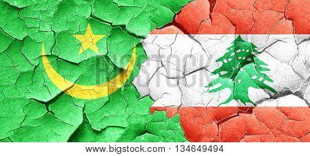 Mauritania flag with Lebanon flag on a grunge cracked wall
