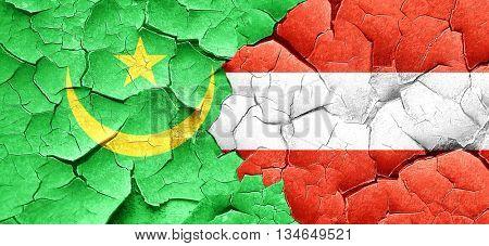 Mauritania flag with Austria flag on a grunge cracked wall