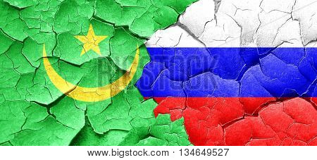 Mauritania flag with Russia flag on a grunge cracked wall