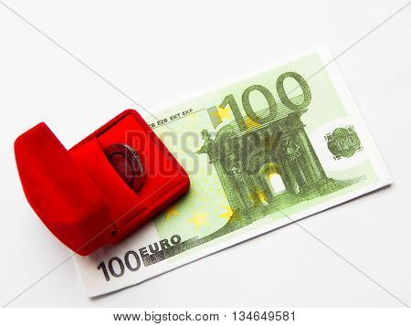 A red box and money on a white background.