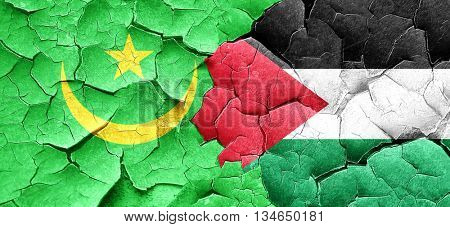 Mauritania flag with Palestine flag on a grunge cracked wall