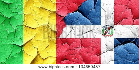 Mali flag with Dominican Republic flag on a grunge cracked wall