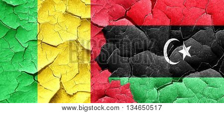 Mali flag with Libya flag on a grunge cracked wall