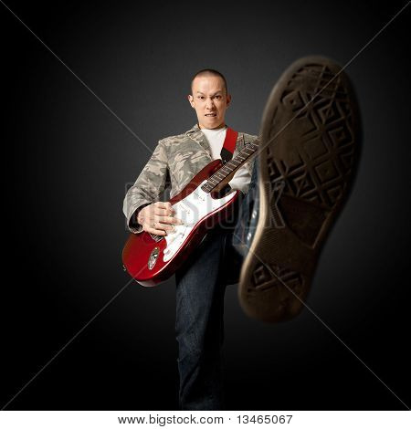 Rocker With Guitar And Foot