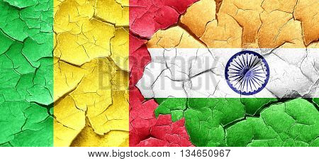 Mali flag with India flag on a grunge cracked wall