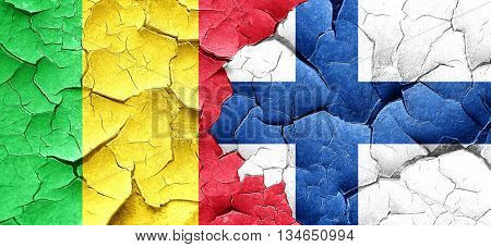 Mali flag with Finland flag on a grunge cracked wall