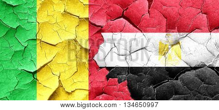 Mali flag with egypt flag on a grunge cracked wall