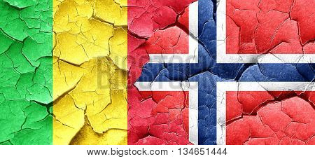 Mali flag with Norway flag on a grunge cracked wall