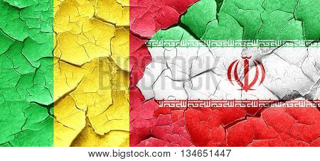 Mali flag with Iran flag on a grunge cracked wall