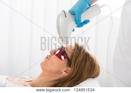 Mature Woman Receiving Laser Hair Removal In Beauty Clinic