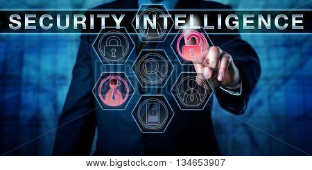 Corporate manager touching SECURITY INTELLIGENCE on a virtual interactive control display. Business metaphor and cyber security concept for counter measures and expertise to protect valuable assets.