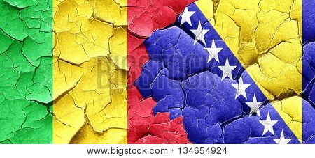 Mali flag with Bosnia and Herzegovina flag on a grunge cracked w