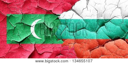 Maldives flag with Bulgaria flag on a grunge cracked wall