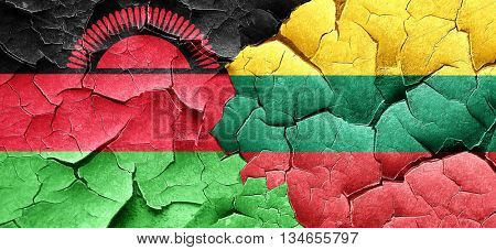 Malawi flag with Lithuania flag on a grunge cracked wall