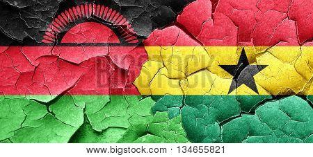 Malawi flag with Ghana flag on a grunge cracked wall