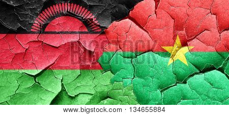 Malawi flag with Burkina Faso flag on a grunge cracked wall