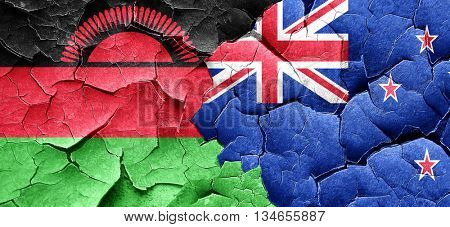 Malawi flag with New Zealand flag on a grunge cracked wall