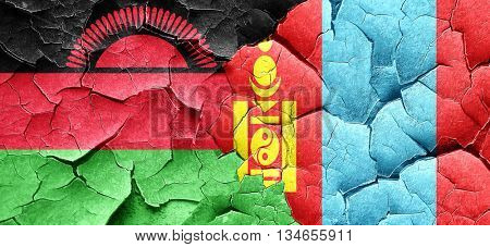 Malawi flag with Mongolia flag on a grunge cracked wall
