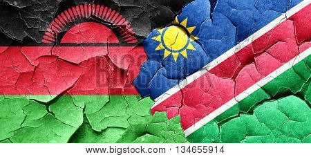 Malawi flag with Namibia flag on a grunge cracked wall
