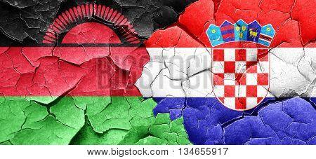 Malawi flag with Croatia flag on a grunge cracked wall
