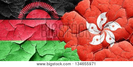 Malawi flag with Hong Kong flag on a grunge cracked wall
