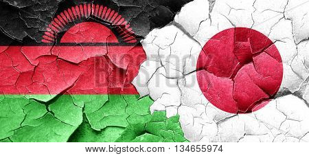 Malawi flag with Japan flag on a grunge cracked wall
