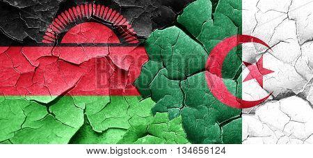 Malawi flag with Algeria flag on a grunge cracked wall