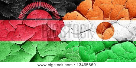 Malawi flag with Niger flag on a grunge cracked wall