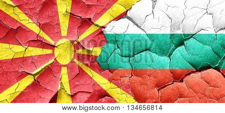 Macedonia flag with Bulgaria flag on a grunge cracked wall