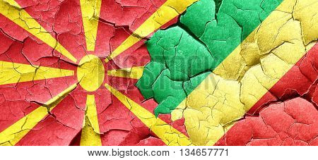 Macedonia flag with congo flag on a grunge cracked wall