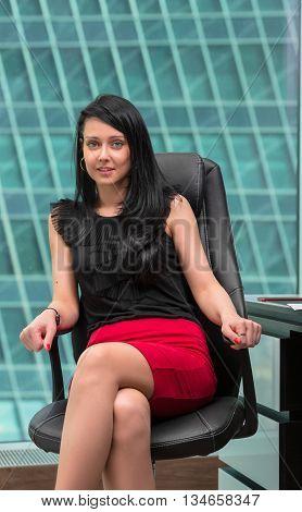 portrait of girl office worker in skyscraper interior