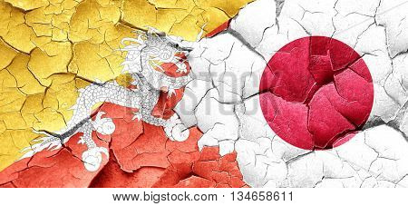 Bhutan flag with Japan flag on a grunge cracked wall