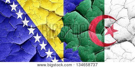 Bosnia and Herzegovina flag with Algeria flag on a grunge cracke