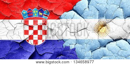 croatia flag with Argentine flag on a grunge cracked wall
