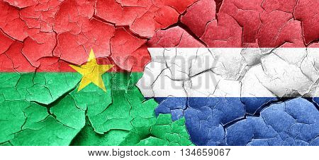 Burkina Faso flag with Netherlands flag on a grunge cracked wall