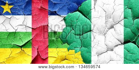 Central african republic flag with Nigeria flag on a grunge crac