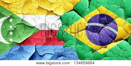 Comoros flag with Brazil flag on a grunge cracked wall