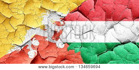 Bhutan flag with Hungary flag on a grunge cracked wall