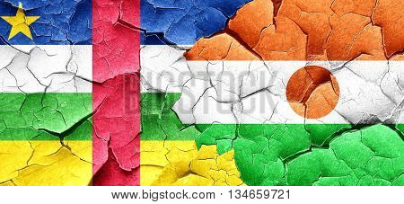 Central african republic flag with Niger flag on a grunge cracke