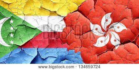 Comoros flag with Hong Kong flag on a grunge cracked wall