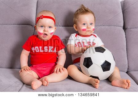 Soccer baby fans of Poland team in national colors
