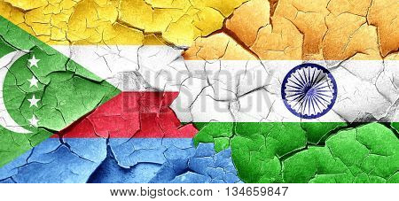 Comoros flag with India flag on a grunge cracked wall
