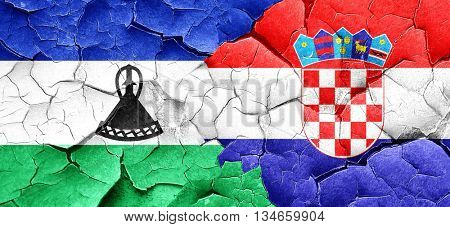 Lesotho flag with Croatia flag on a grunge cracked wall