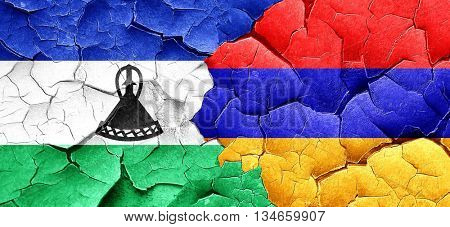 Lesotho flag with Armenia flag on a grunge cracked wall