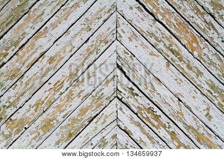Old grey wood plank in a herringbone pattern