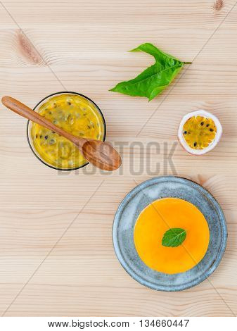 Passion Fruit Cheesecake With Fresh Mint Leaves On Wooden Background. Passion Fruit Cheesecake Setup