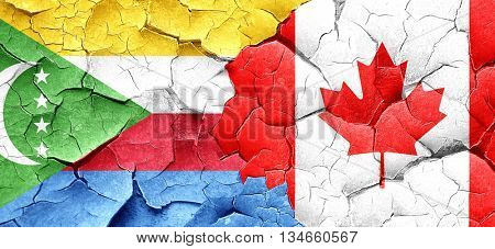 Comoros flag with Canada flag on a grunge cracked wall